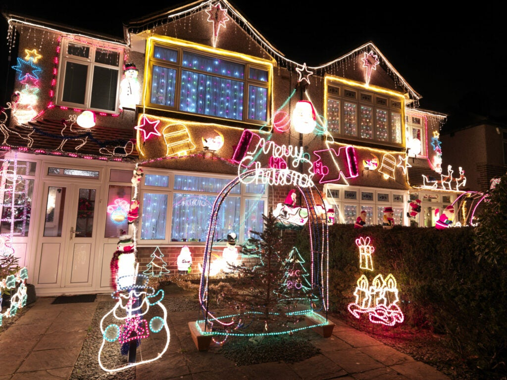 Houses covered with lights and  christmas decorations.