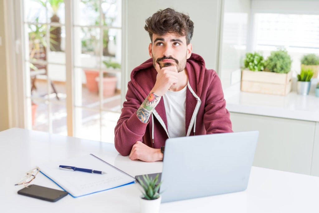 Young student man using computer laptop
