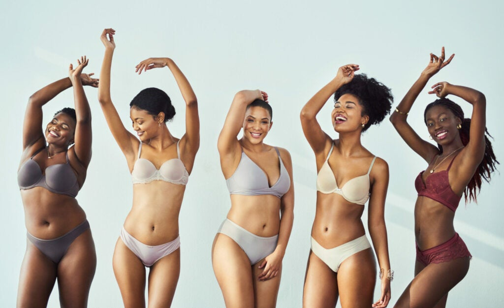 Studio shot of a group of beautiful young women posing together in their underwear