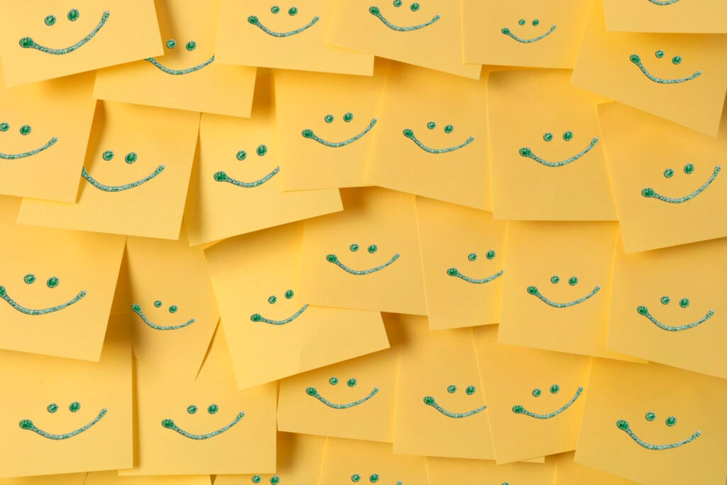 Adhesive note with smiles