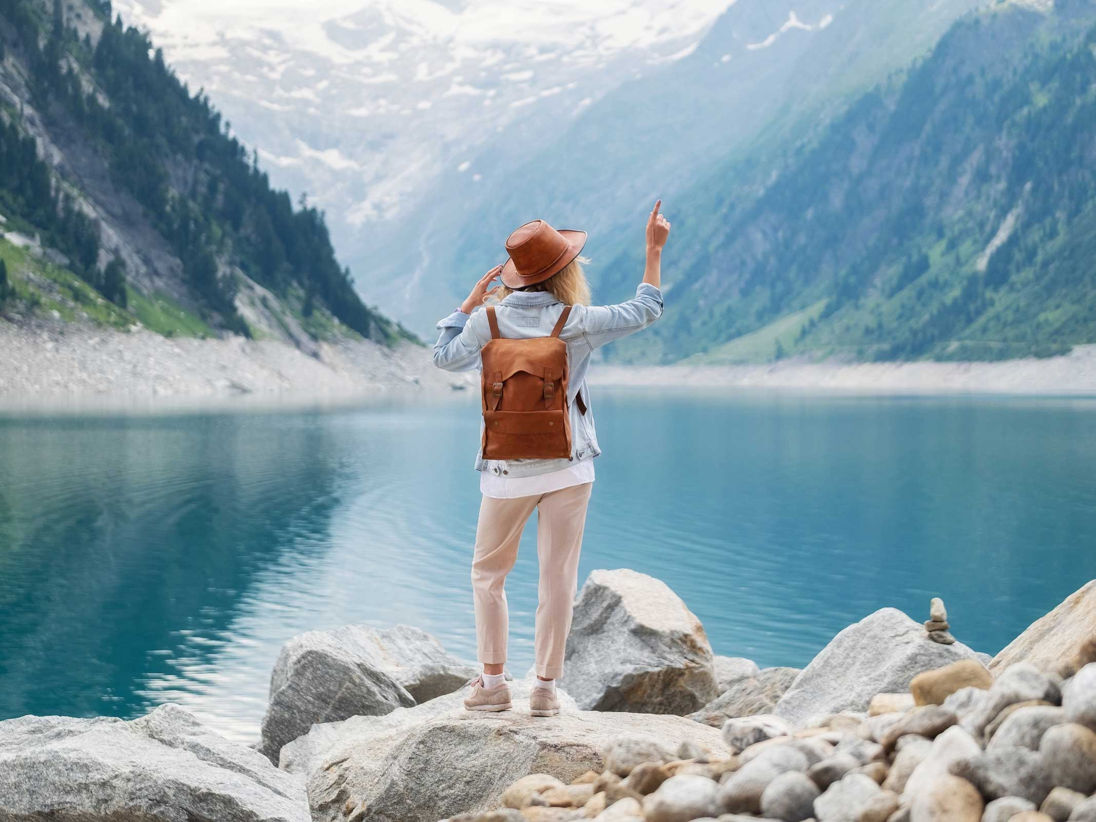 Woman on lake with backpack