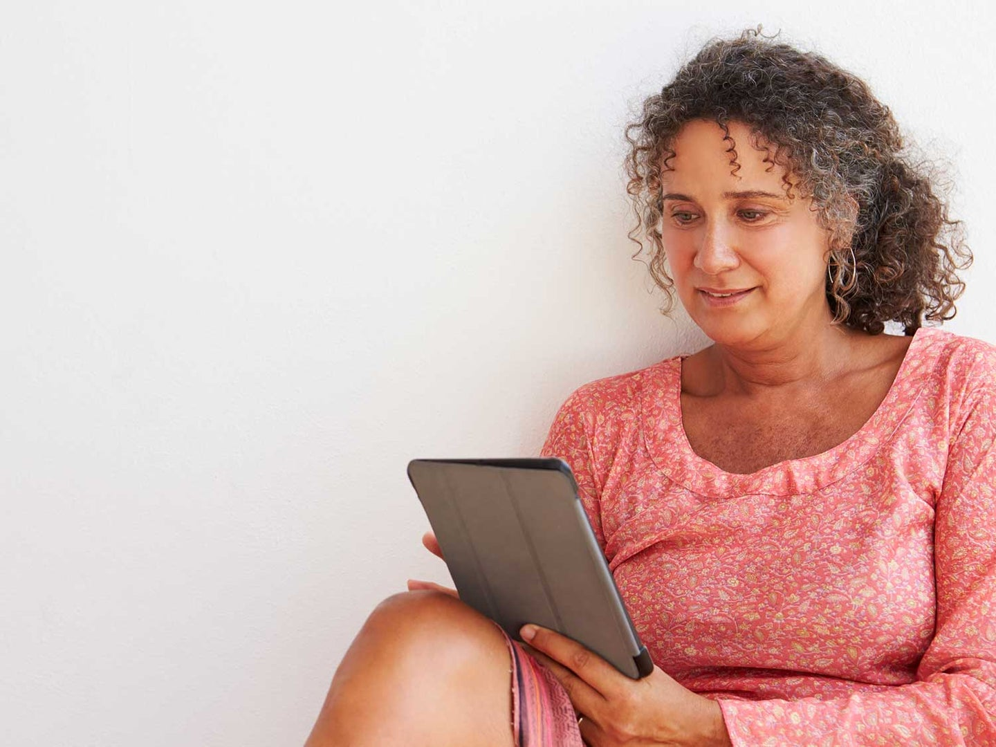 Older woman with device.