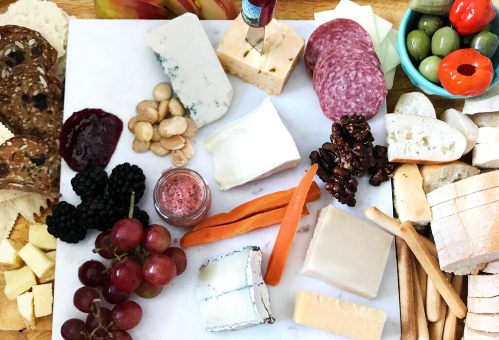 Cheeseboard with salami and grapes