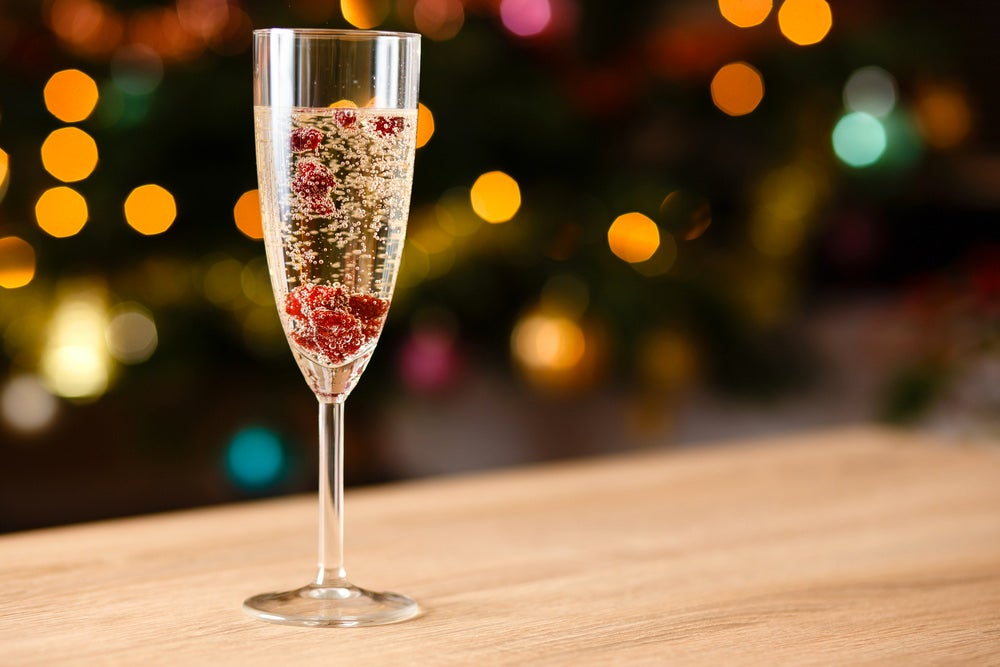 Champagne glass with cranberry in it