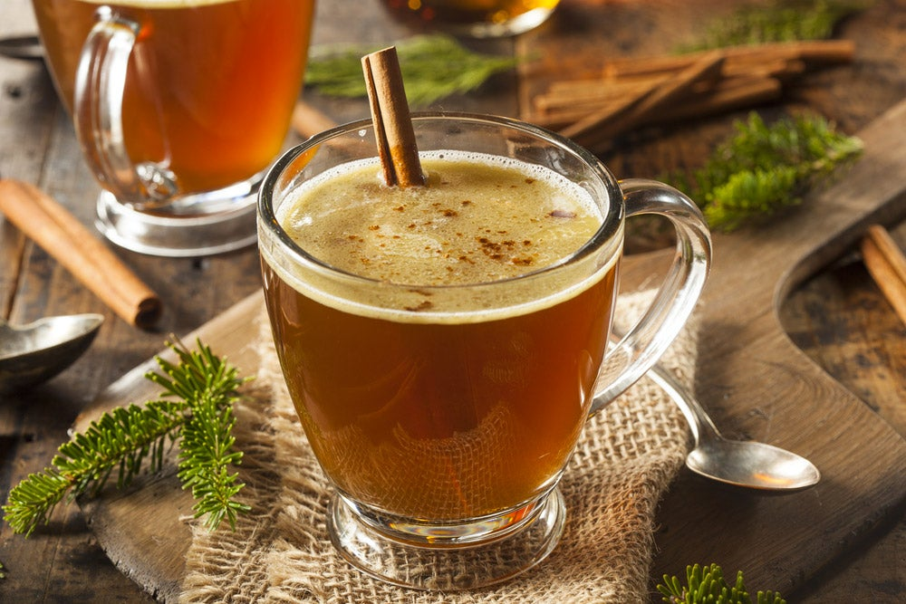 Hot buttered rum cocktail with cinnamon stick