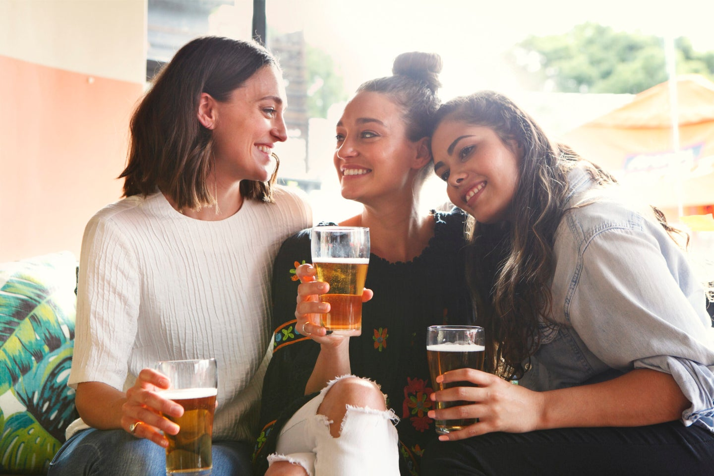 Young girls drinking and having fun together