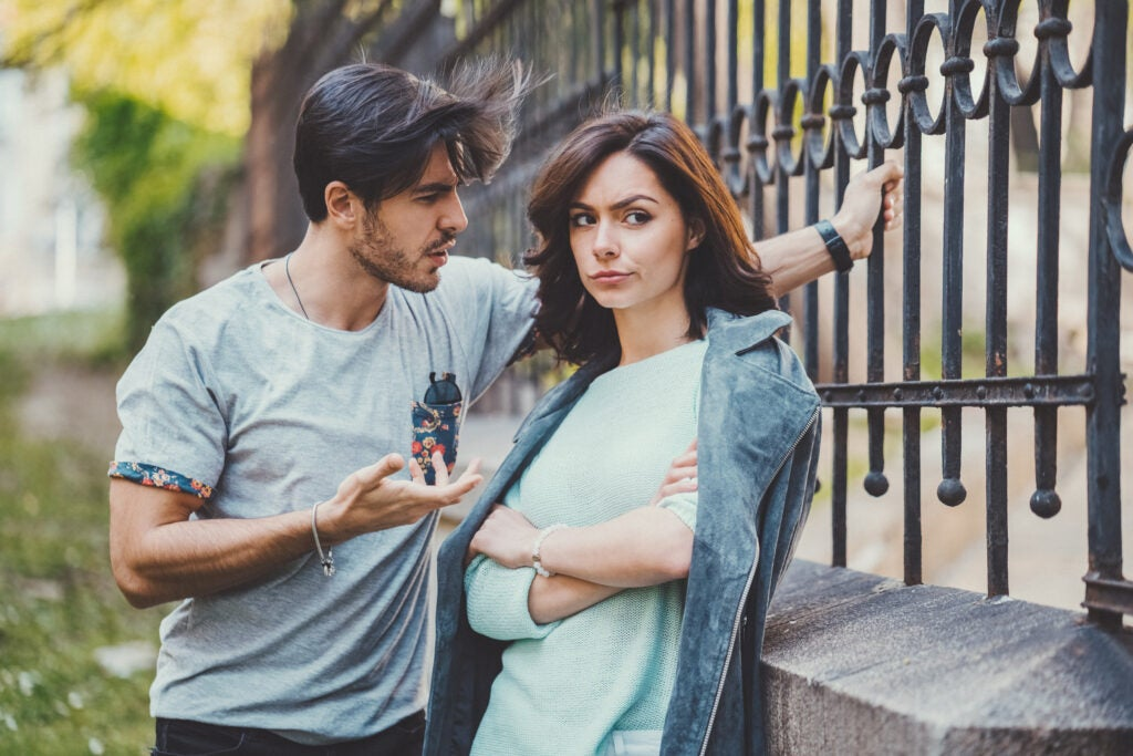 Unhappy couple outside talking about problems