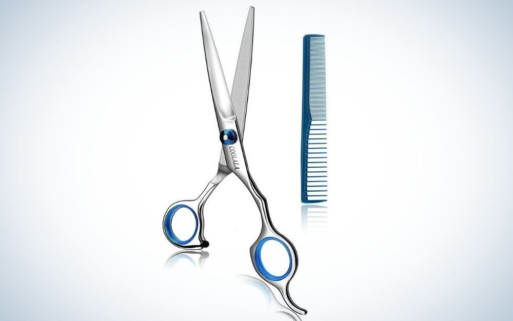 A pair of silver scissors with blue stripes on the circles where it is held with the fingers, which are used to cut hair, as well as a small and fine blue comb.