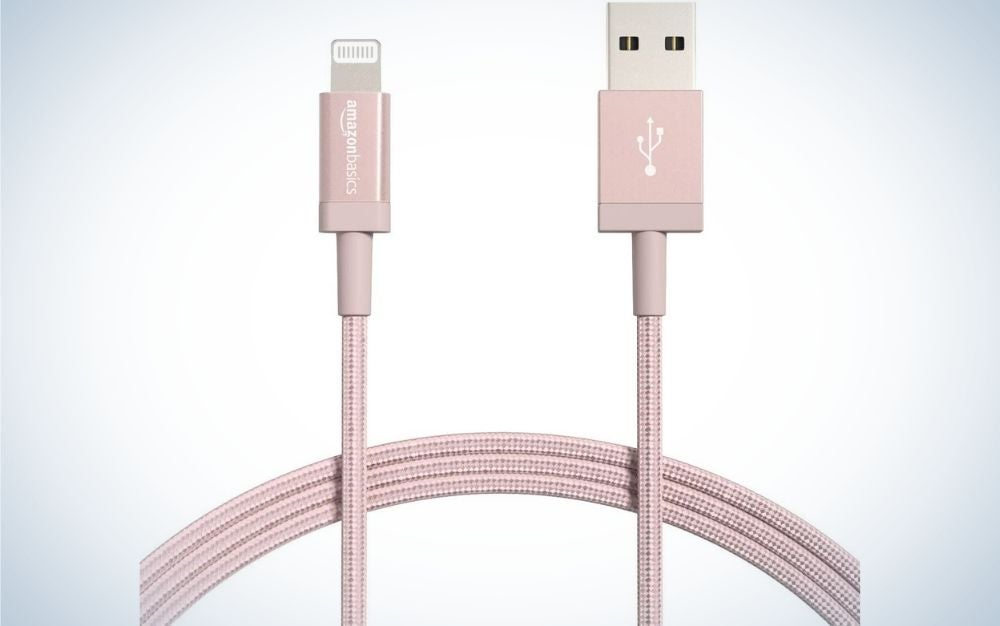 A charger with pink cable wrapped and apparently only two parts of his head.