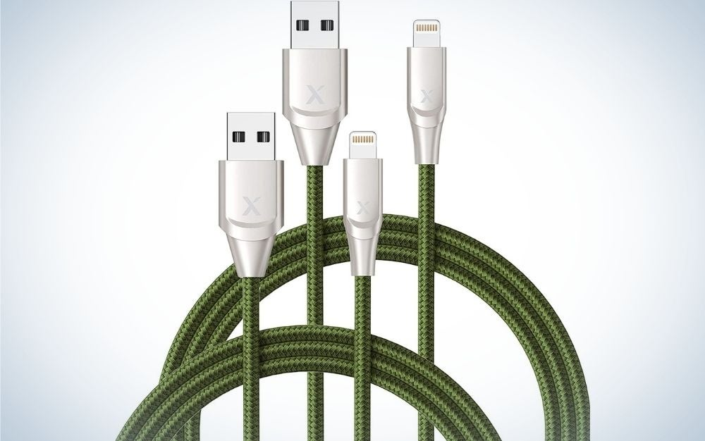A charger with green cable wrapped and apparently four parts of his head of different sizes.