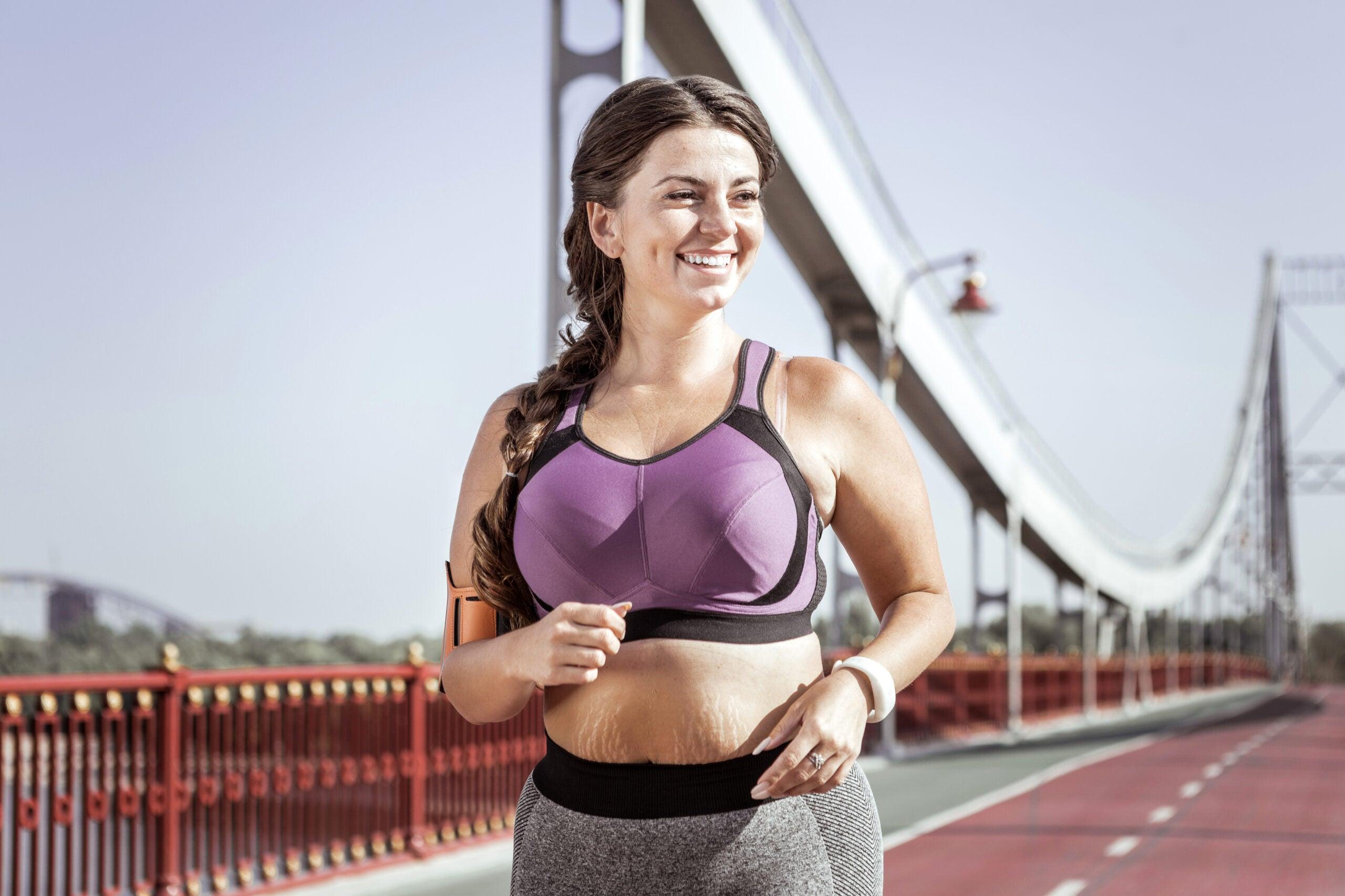 Happy nice young woman fighting her weight