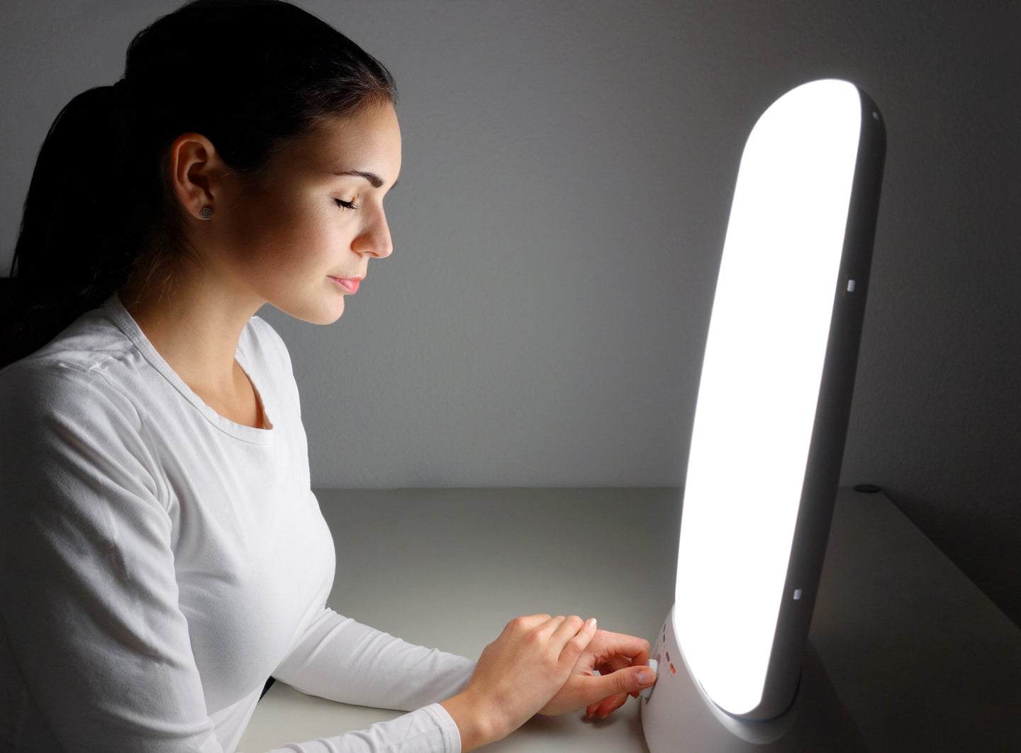Sitting in front of a therapy lamp for