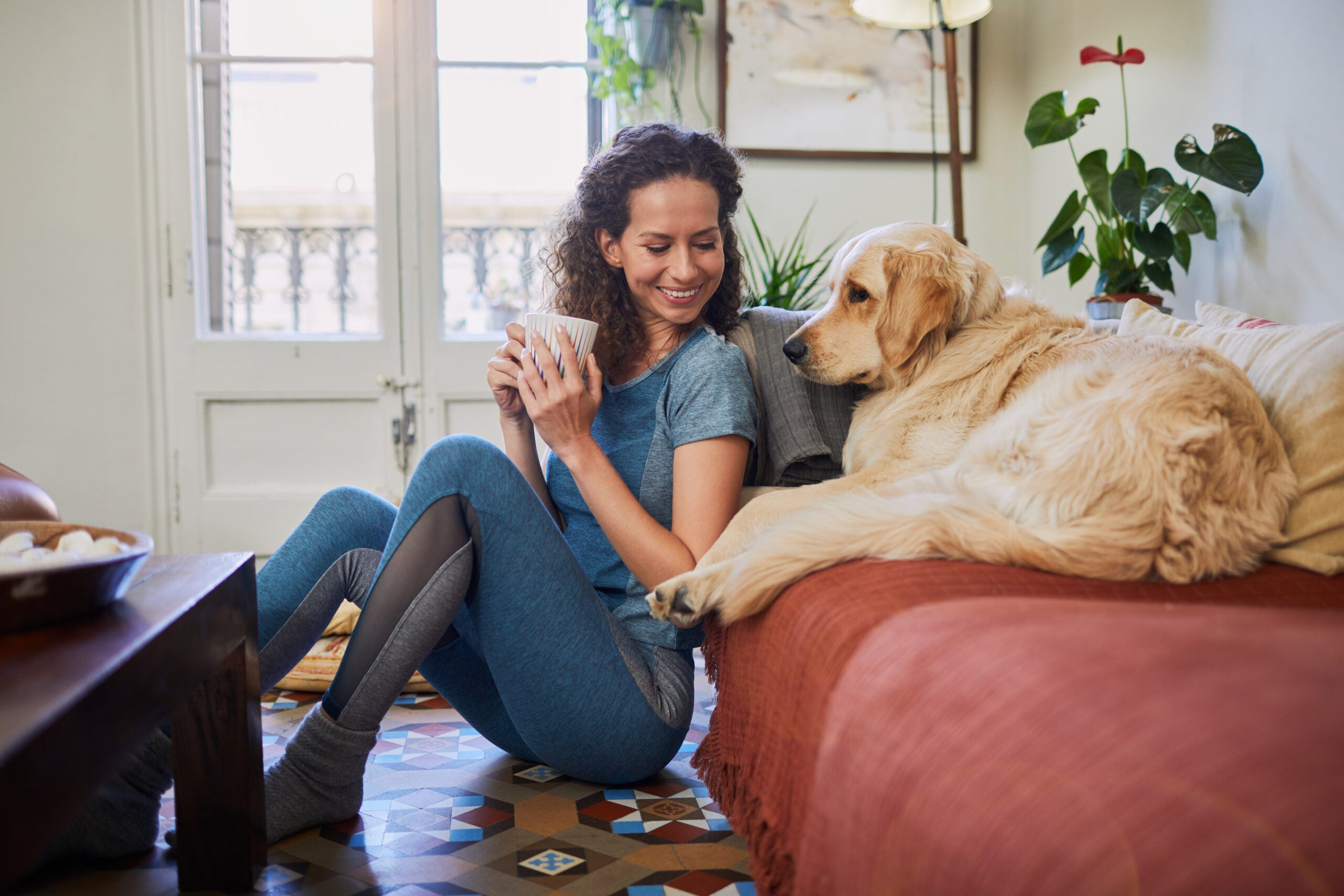adult woman at home with pet dog.