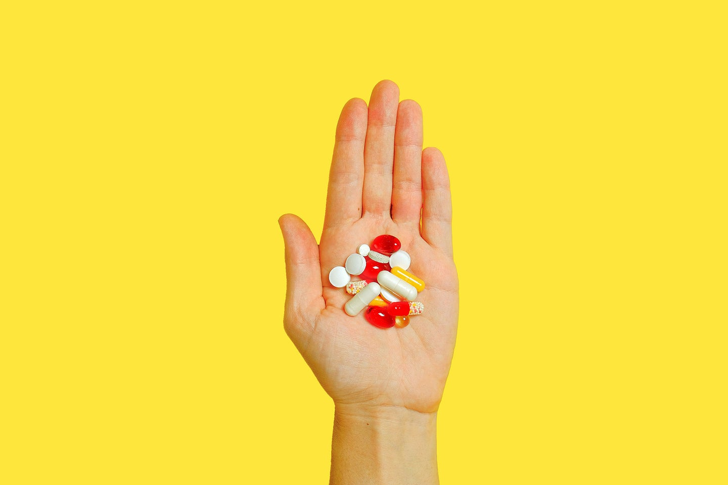 Person holding pills
