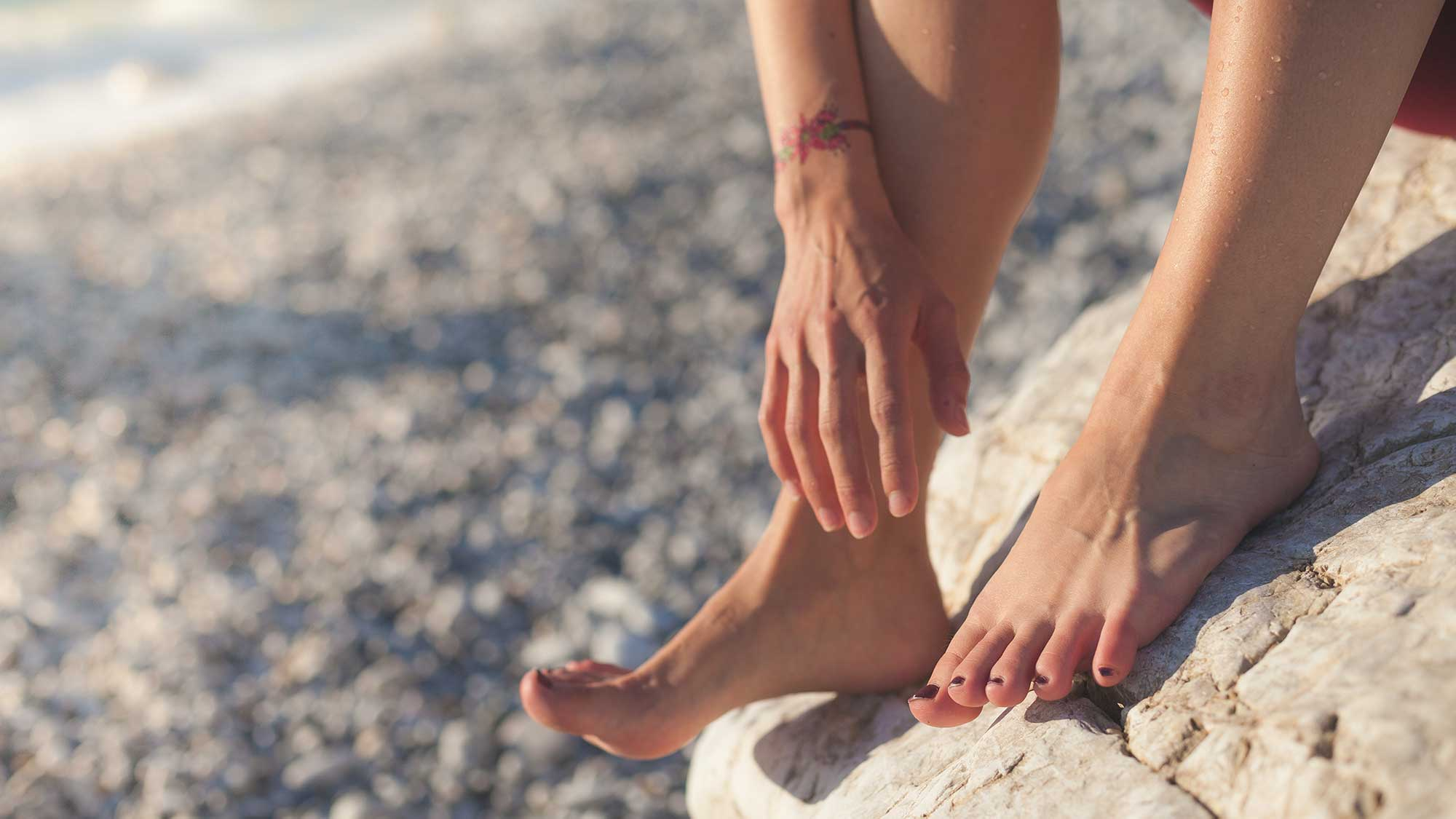 Close up of woman's feet on the beach