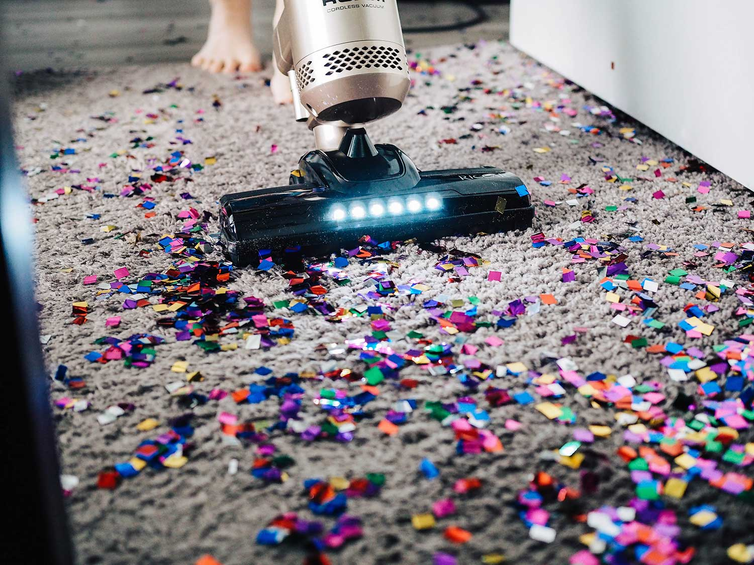 Vacuuming confetti off of carpet with stick vacuum