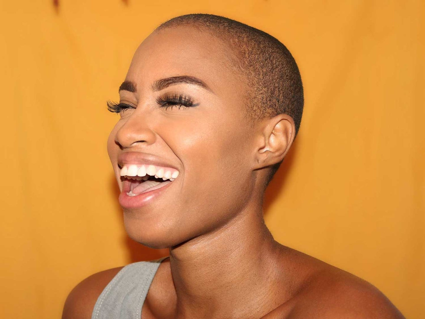 Woman with glowing skin laughing