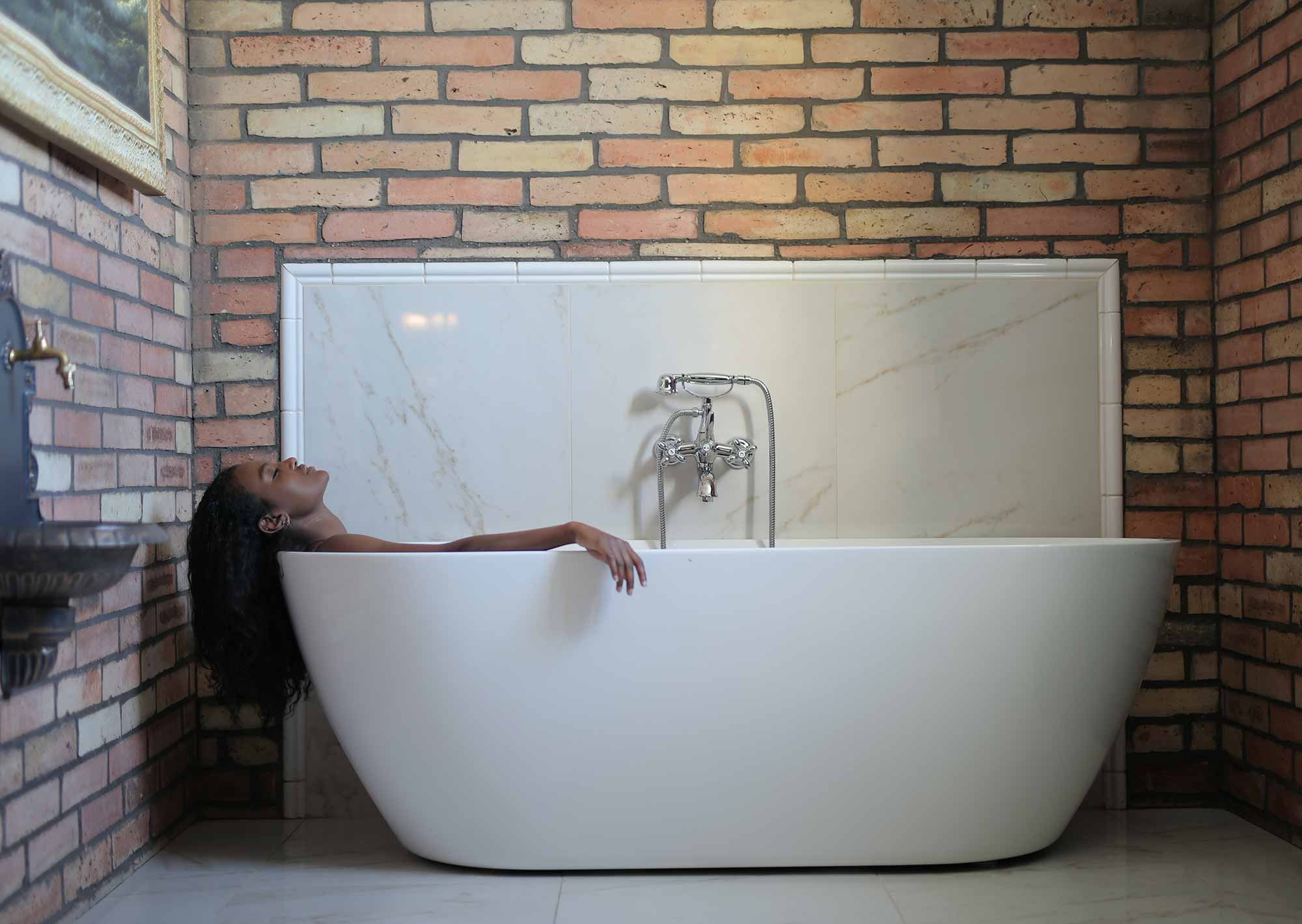 Woman relaxing in a tub