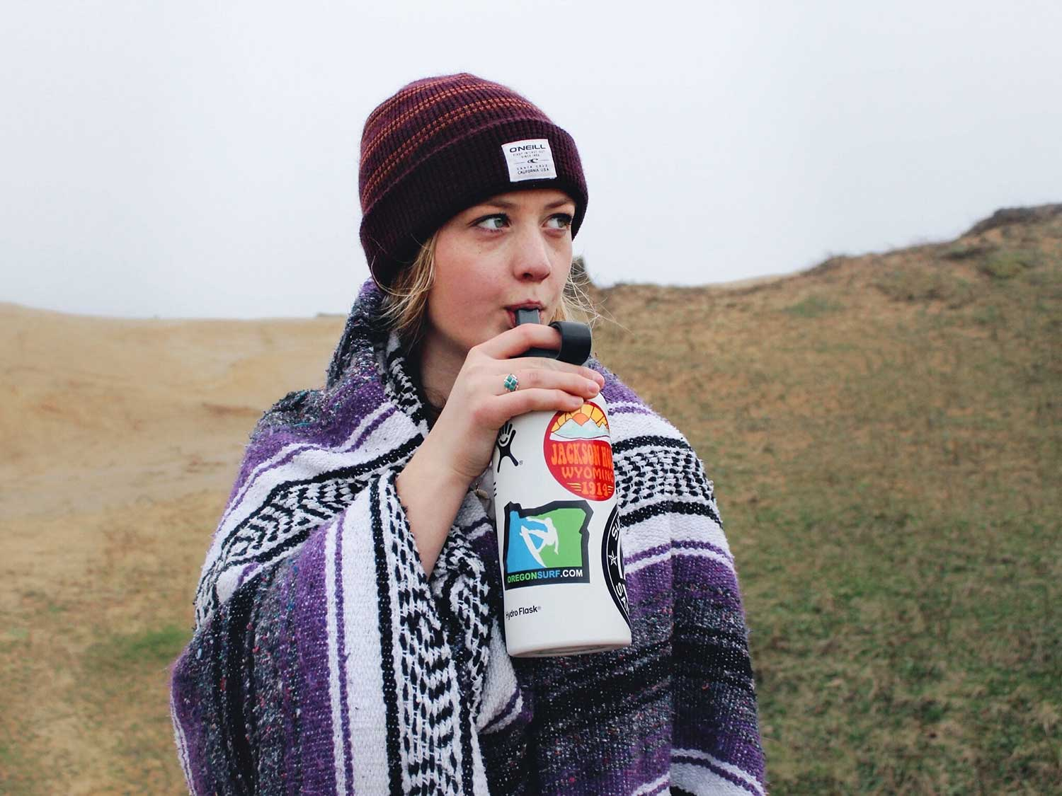 Woman sipping on straw in water bottle