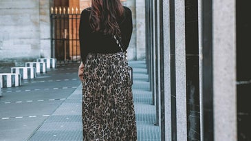 Woman walking away with a skirt on