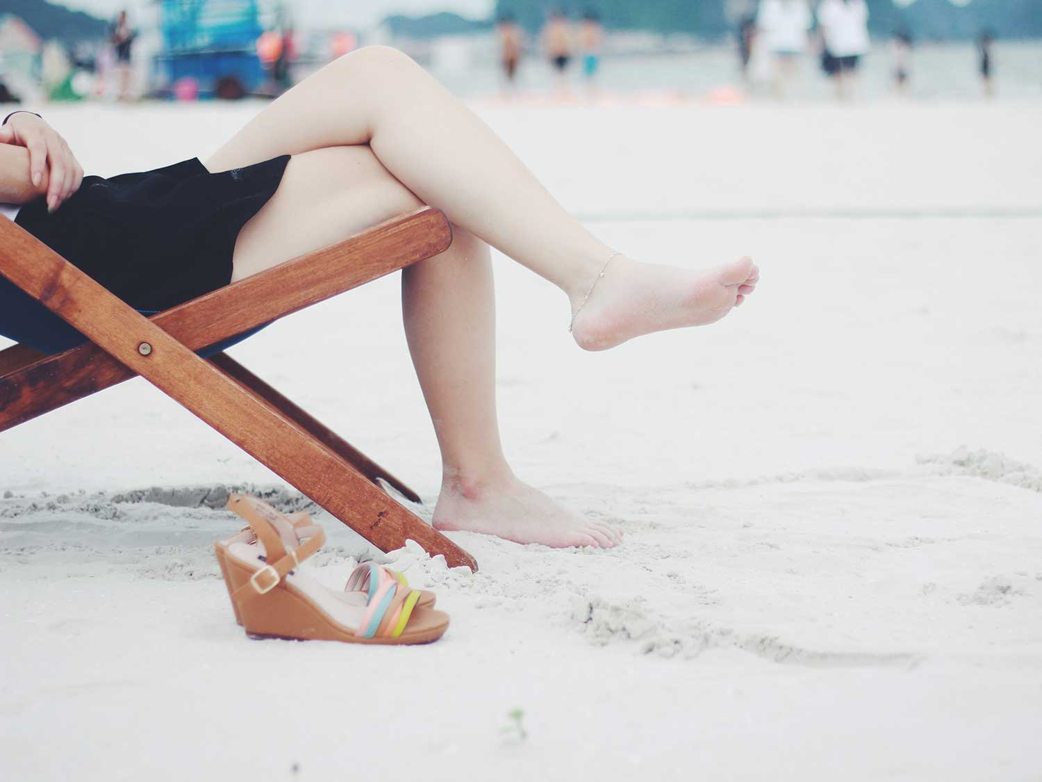 Woman relaxing in beach chair.