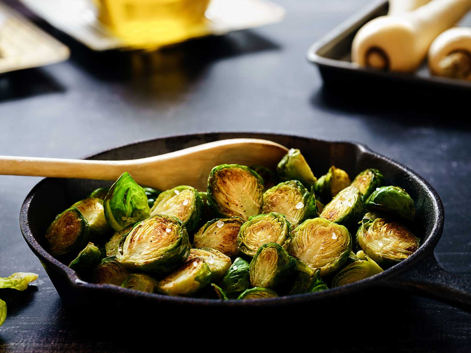 Cast iron skillet with brussels sprouts.