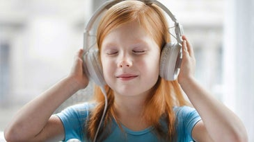 Girl listening to music in headset.