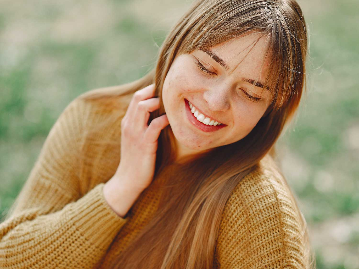 Woman with straight hair smiling.