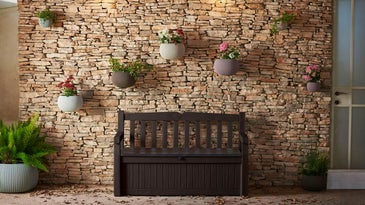Outdoor storage box in front of stone wall