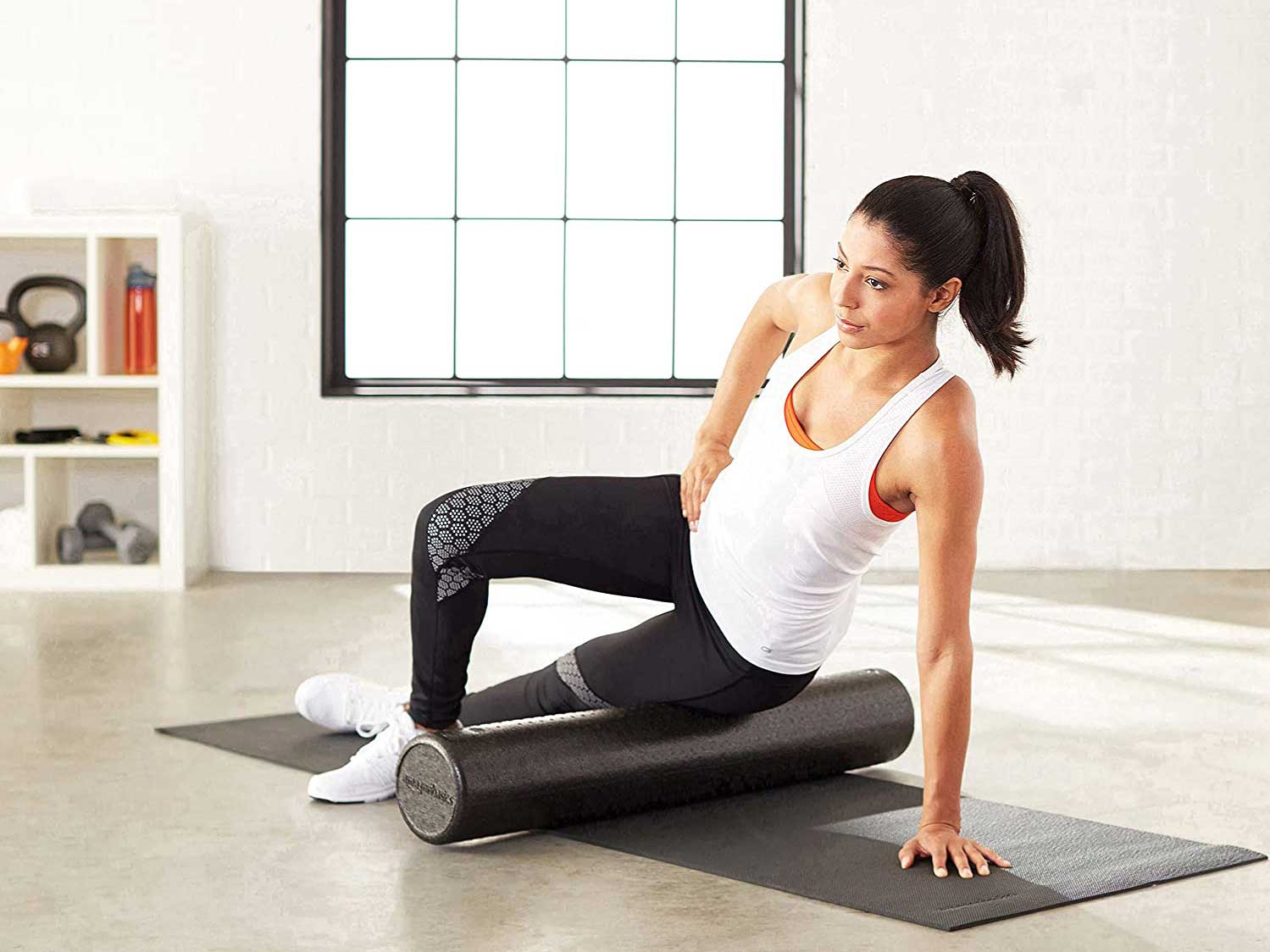 Woman stretching on foam roller.