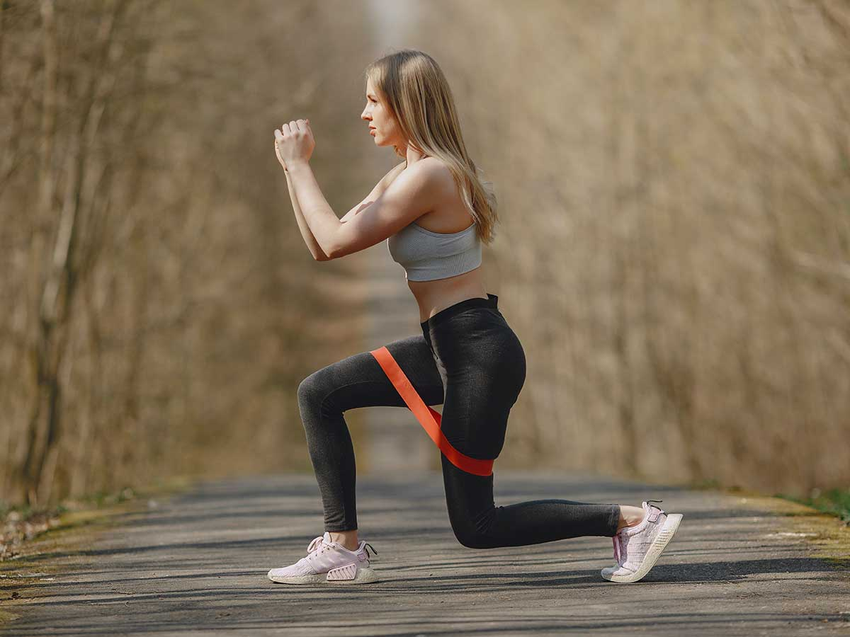 woman exercising with resistant band