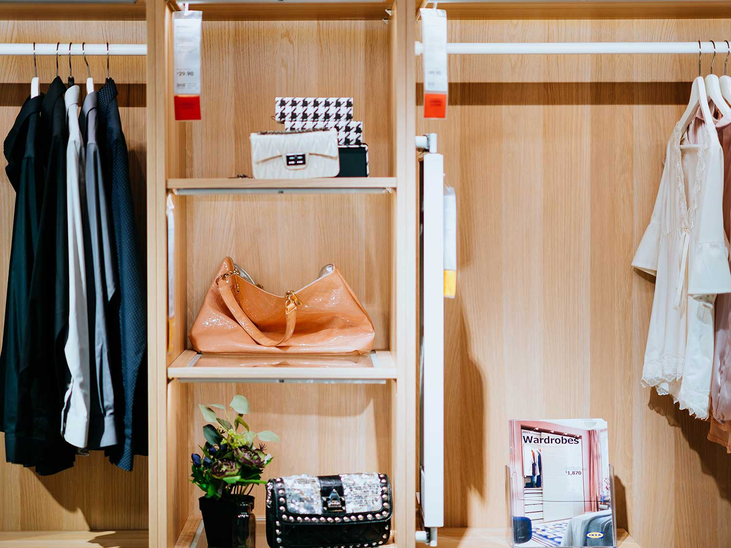 Clothes hanging with accessories in closet.