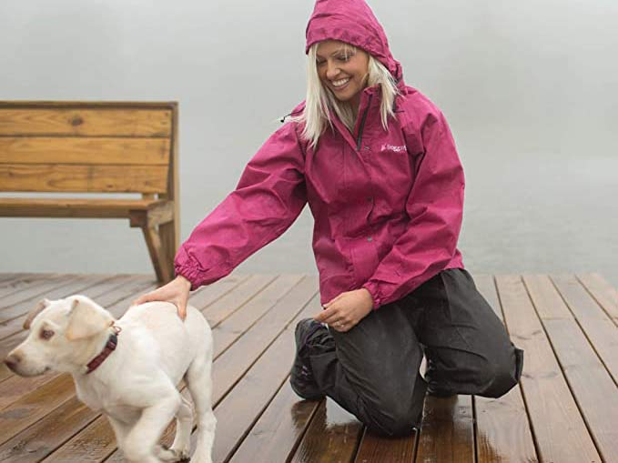 woman playing with puppy in the rain