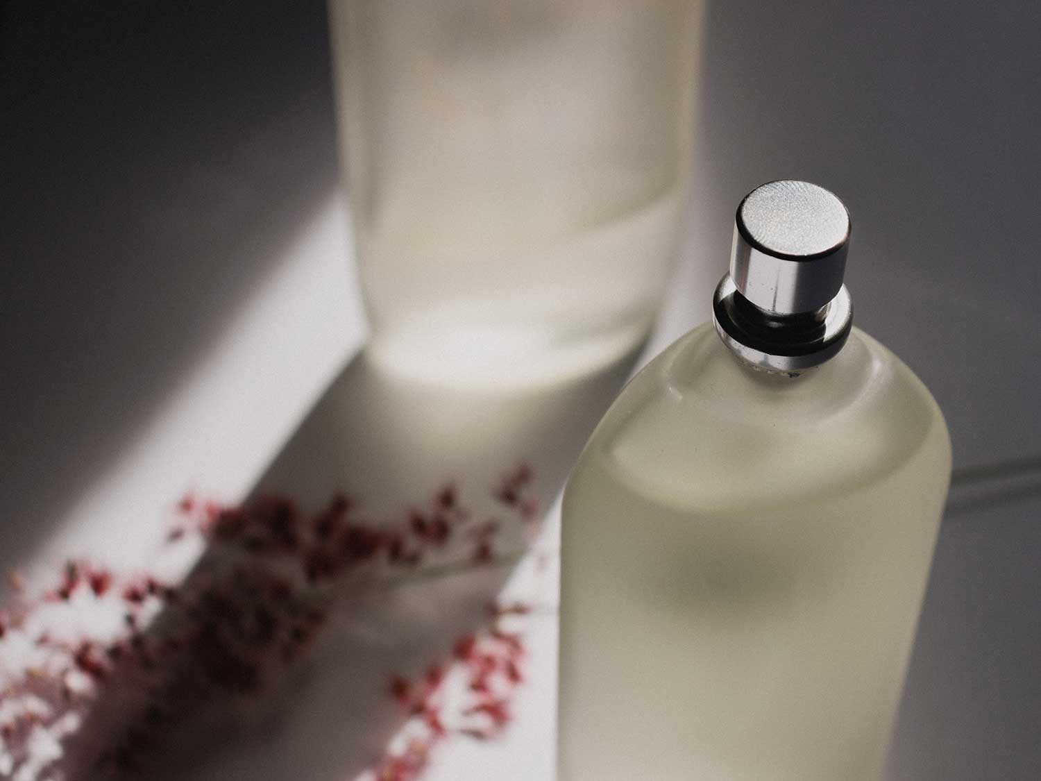 Home fragrance sprays in glass bottles.
