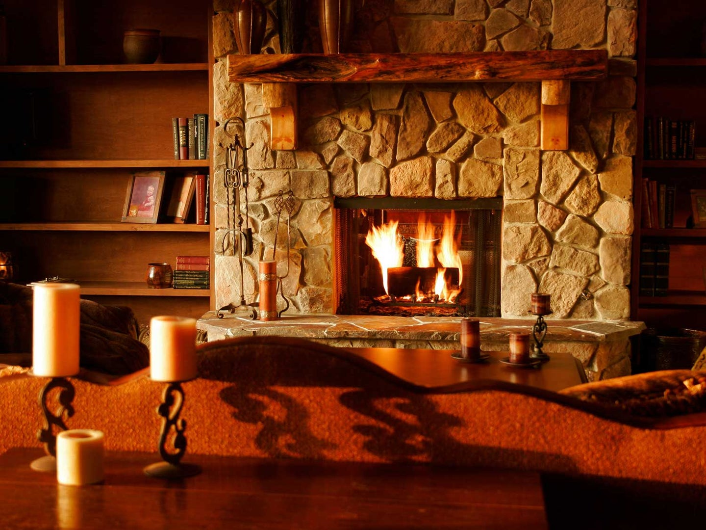 Fireplace with fire burning.