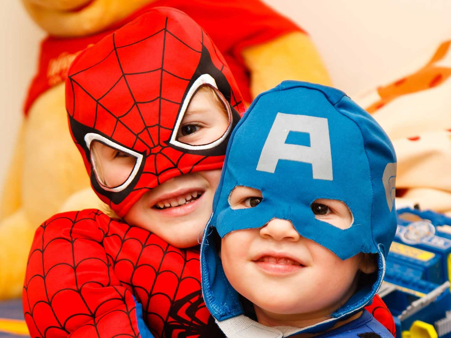Kids wearing Spiderman and Captain America costumes.