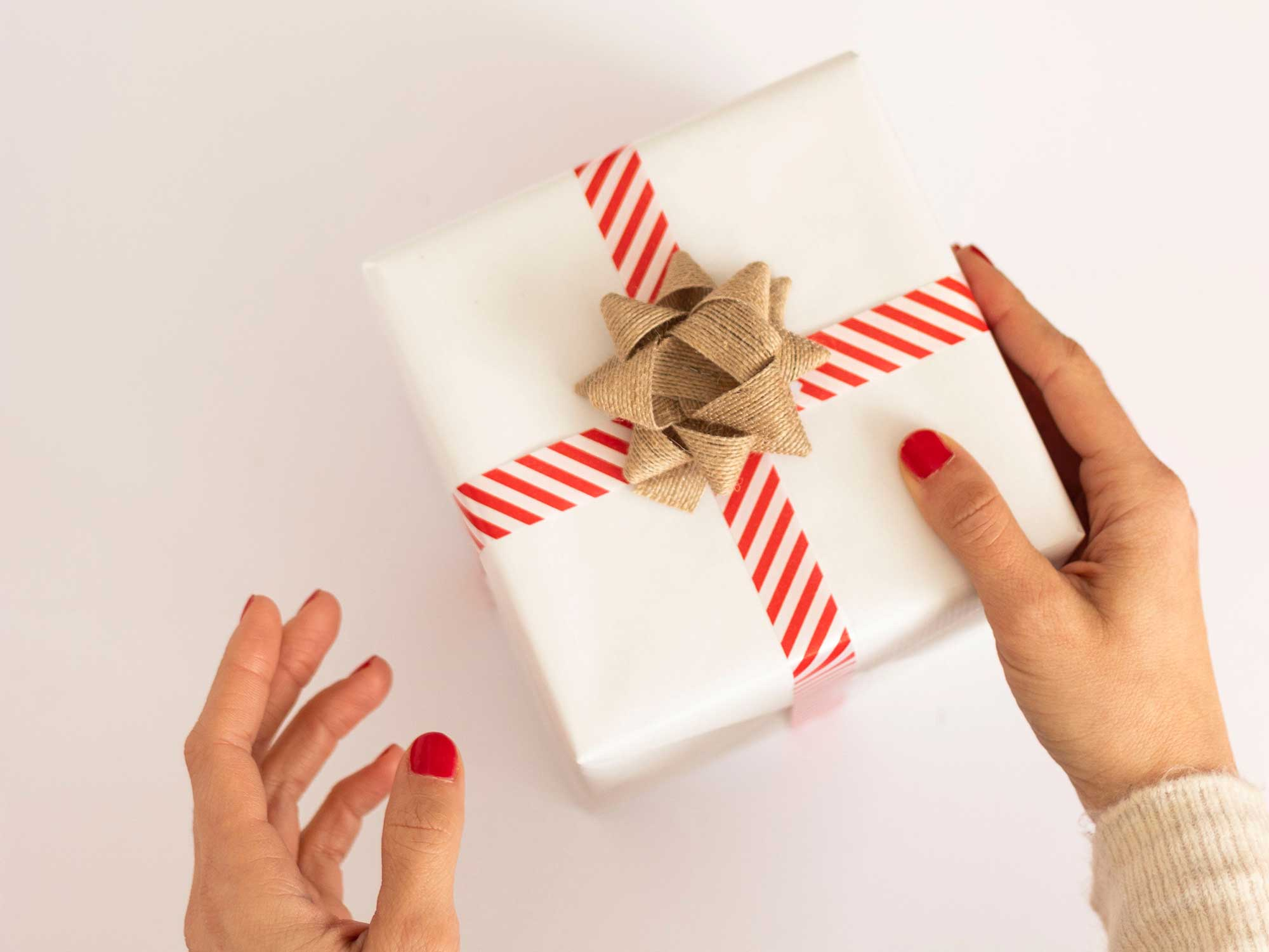 A woman's hands holding a present