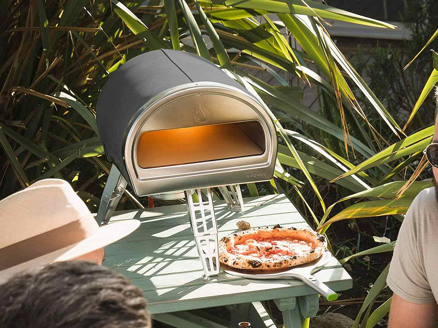 Pizza oven outside cooking pizza.