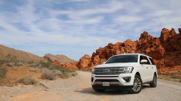 White SUV in the mountains