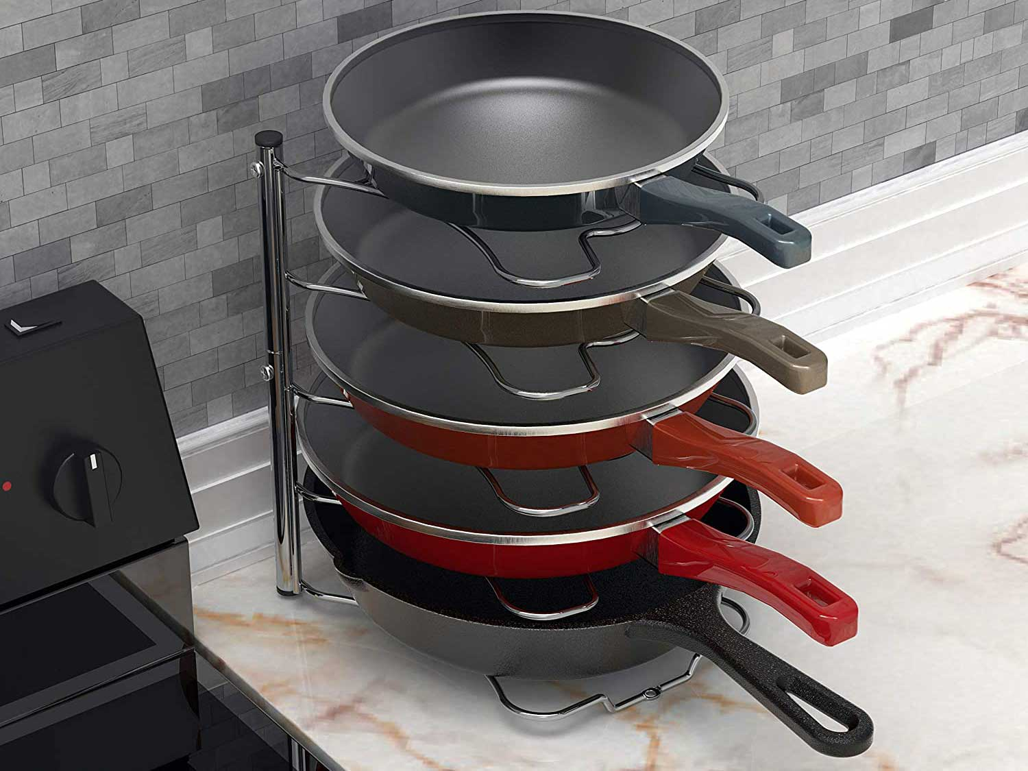 Pot rack with skillets stacked.