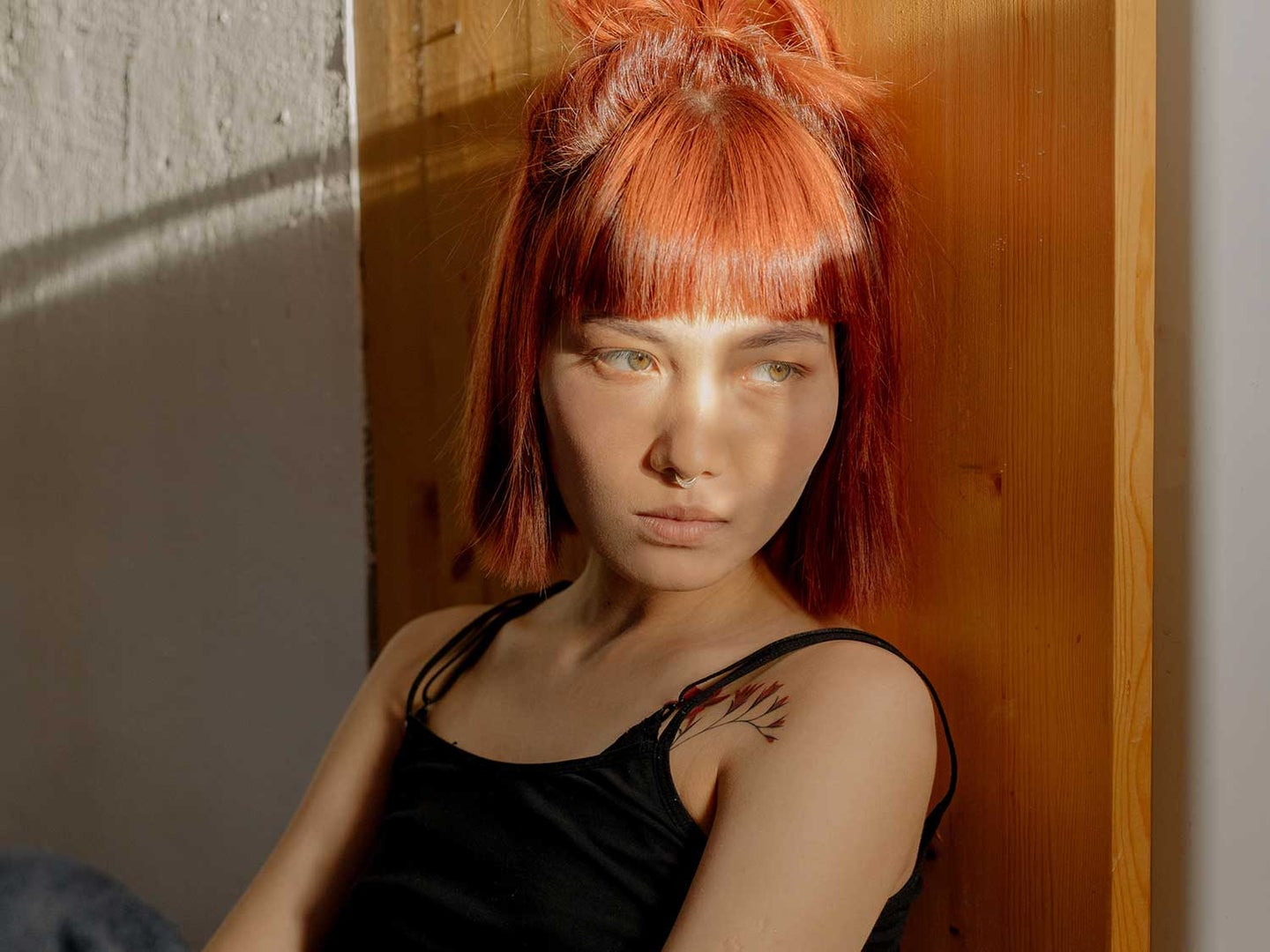 Woman with red dyed hair.
