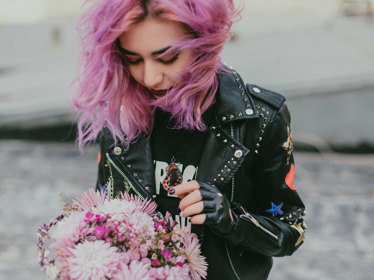 Woman with colorful purple hair and flowers.