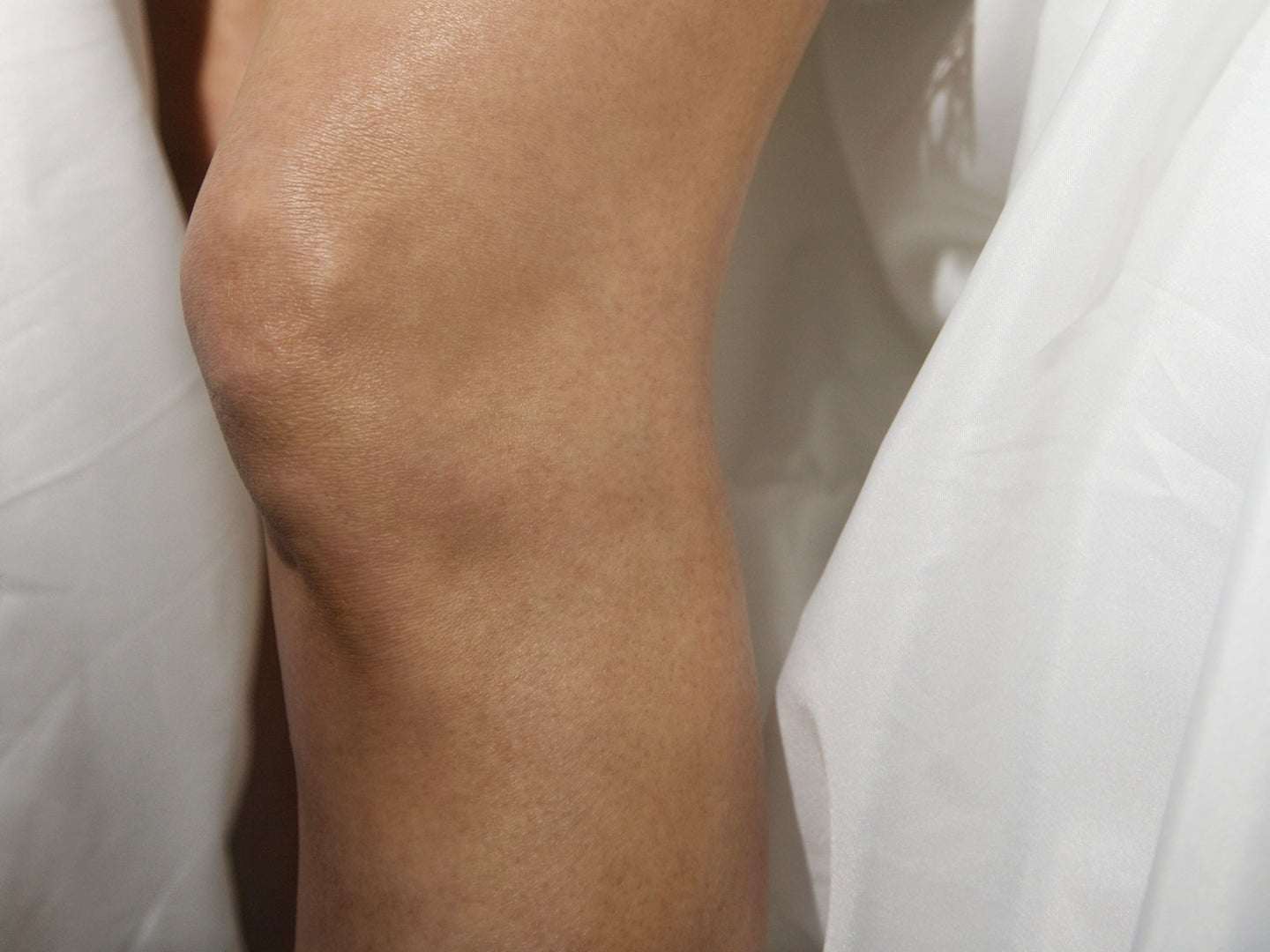 Close up of a woman's knees.