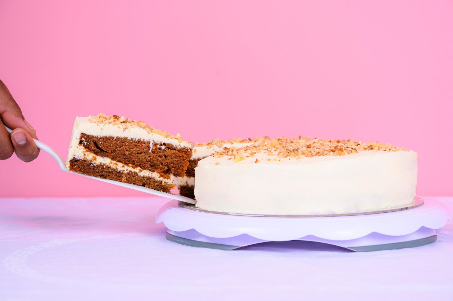 Carrot cake on pink background