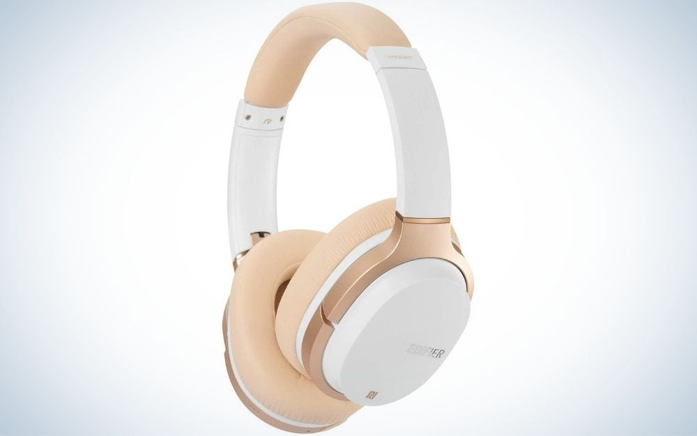 Golden rose and white wireless headphones from side.