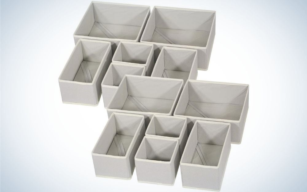 Grey storage boxes that are containers drawers and include 4 large square organizer bins, 4 small square organizer bins, and 4 medium rectangular organizer bins.
