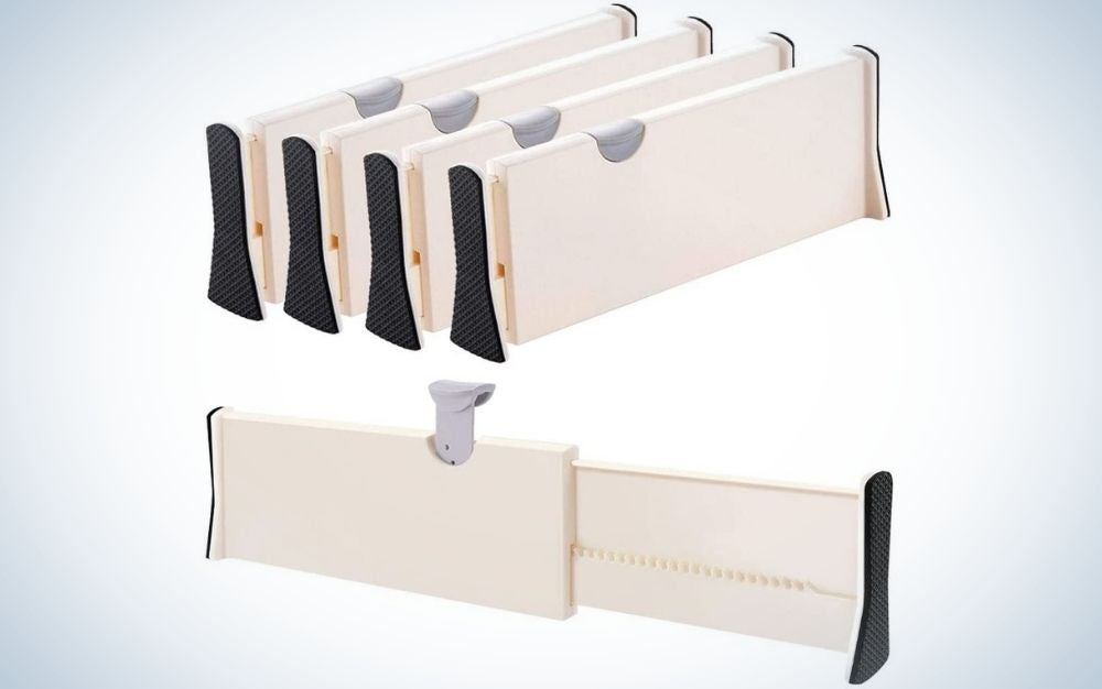 White Drawer Dividers Organizer 4 Pack with adjustable separators, with black covers on the corners.