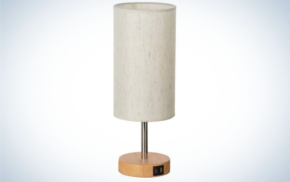 White cylindrical Lamp with a metallic golden lamp base.