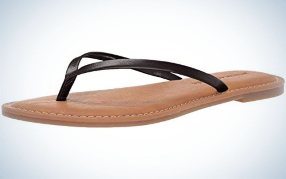 Black and pink thong sandal from beside.