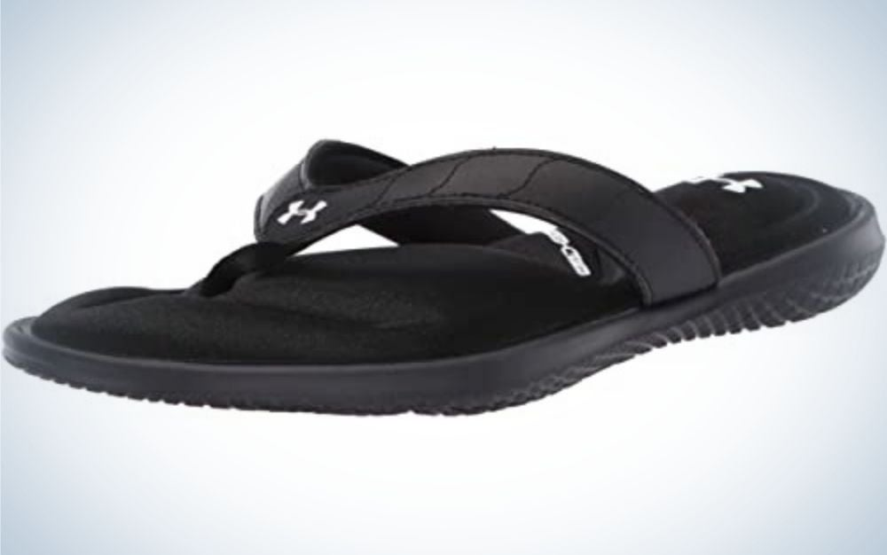 A black pair of slippers picture from beside.